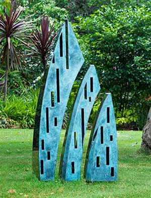 Tall, modern garden sculpture comprising a trio of bronze and stainless steel elements that appear to split and reassemble
