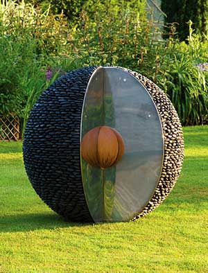 Metal garden sculpture made from oxidised and mirror polished stainless steel