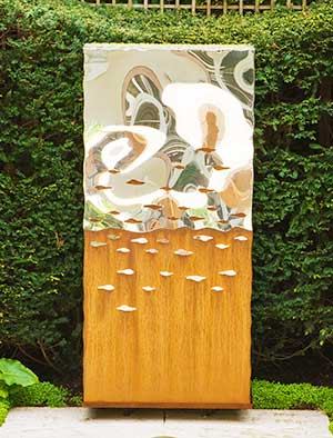 Large abstract outdoor sculpture of oxidised and mirror polished stainless steel