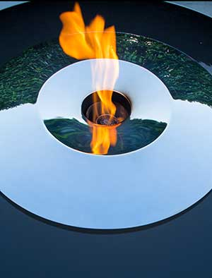 Fire pit water feature in stainless steel