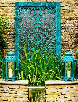 Garden water walls in stainless steel, bronze, copper and glass