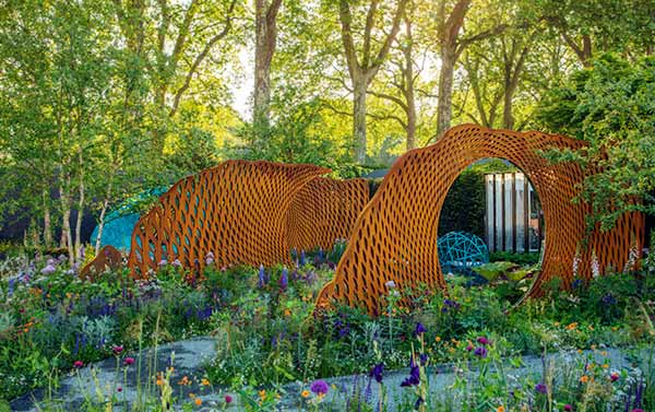 Series of screens in a woodland setting at the Chelsea Show Garden