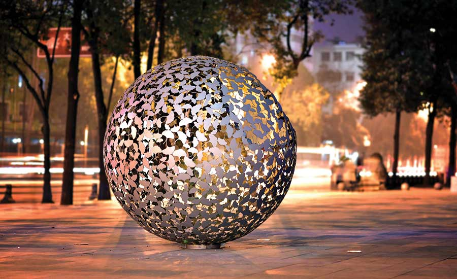 Bespoke sculpture for retail centre made of petals and glittering gold