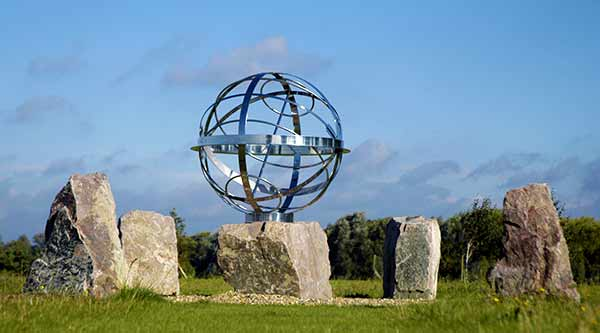 Armillary sphere sundial surrounded by monoliths at Eton Colleg rowing centre