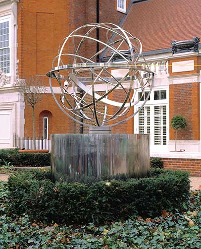 Large stainless steel armillary sphere, luxury property development, Kensington, London
