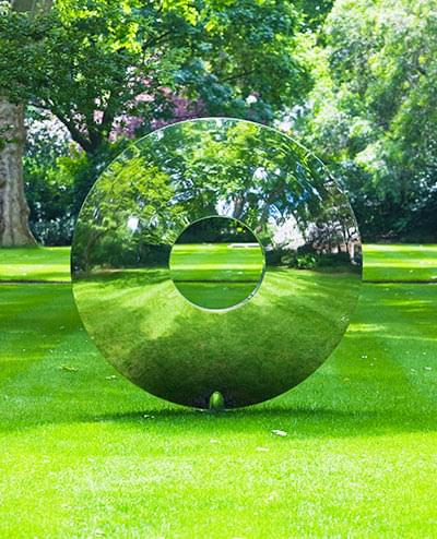 The Torus interacts with its setting by blending and reflecting