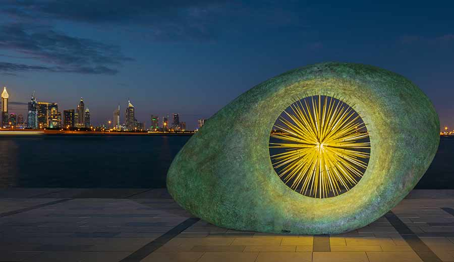 Large Aeon sculpture on the Dubai waterfront at night