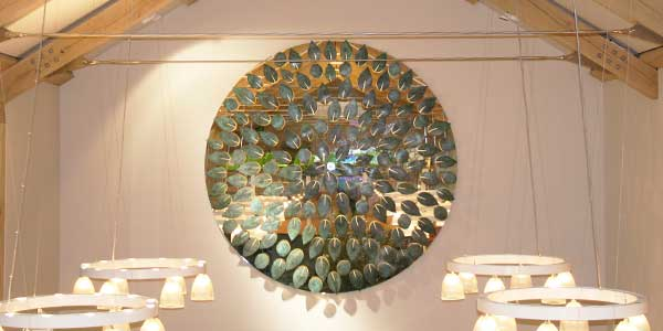 Beautiful logo sculpture made of 160 verdigris bronze leaves lined with gold leaf