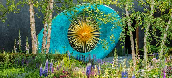 Aeon in its setting in the Chelsea Flower Show garden