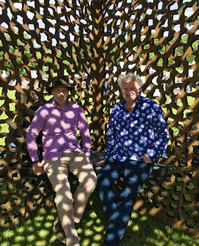 David Harber and Simon Burvill sitting in the Cube sculpture