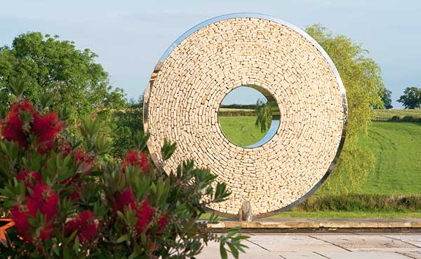 Torus in cotswold stone to match its location