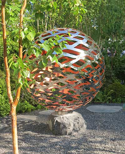 Garden sphere made of vine-like lattice metal work