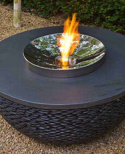 Contemporary garden fire table made of black pebbles