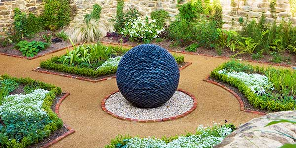 Dark Planet in a formal garden with dog