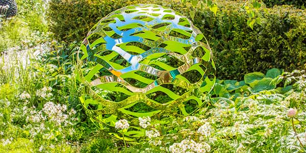 Orb shaped garden art for the outdoors