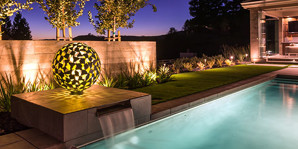 Mantle outdoor sculpture by swimming pool