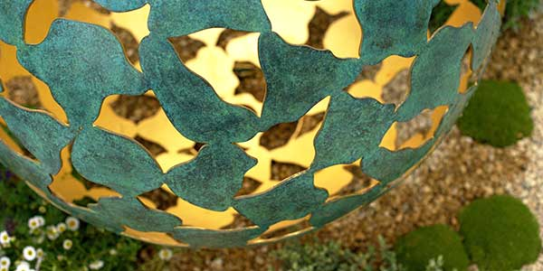 Detail of bronze petals and glittering gold on the Mantle outdoor sculpture