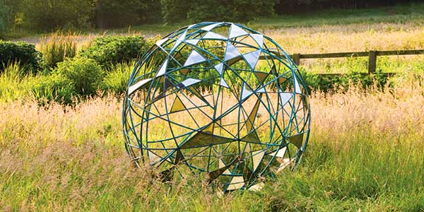 Contemporary orb shaped sculpture for the garden