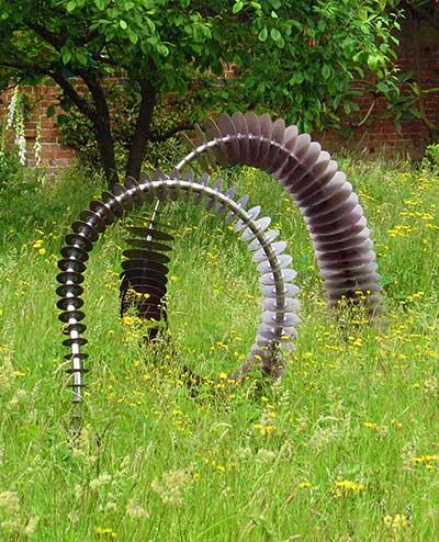 garden art. Coluna Copper Garden Art Snaking Out Of The Grass