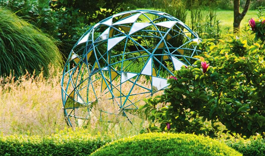 Matrix contemporary sculpture in a pretty garden