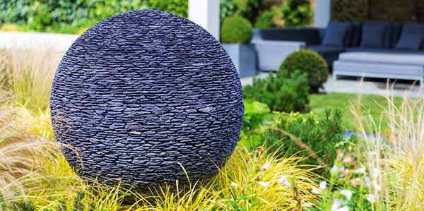 Dark Planet stone garden sphere lit up at night