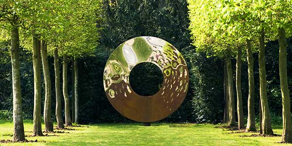 Modern sculpture used as a focal point in a garden