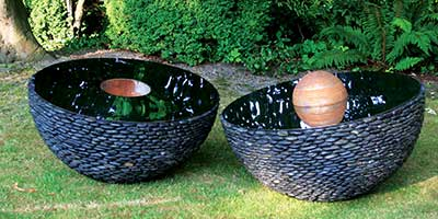 Garden Hemispherical Sculpture: Black Stone Outdoor hemispheres with Stainless Steel Centre