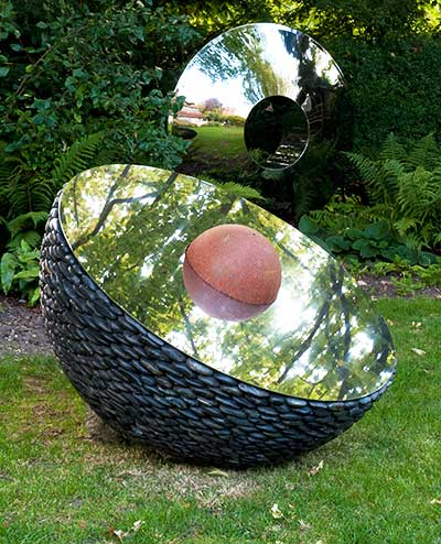 Hemisphere outdoor sculpture in a garden setting