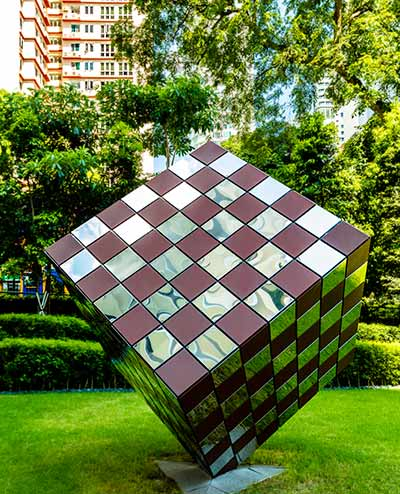 Woven metal cube sculpture,