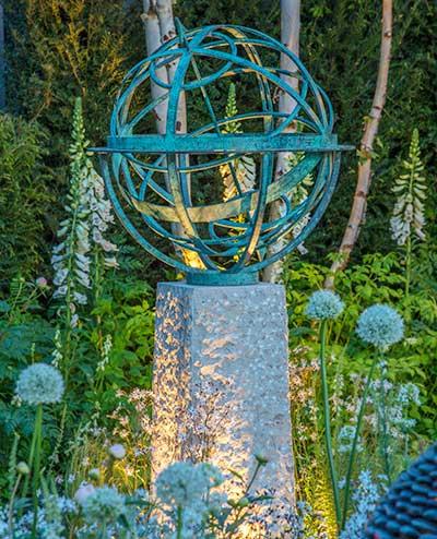 Bronze Sundial In Classic Garden Setting