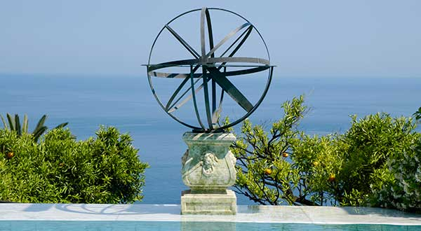 Sphereical brass sundial overlooking the sea