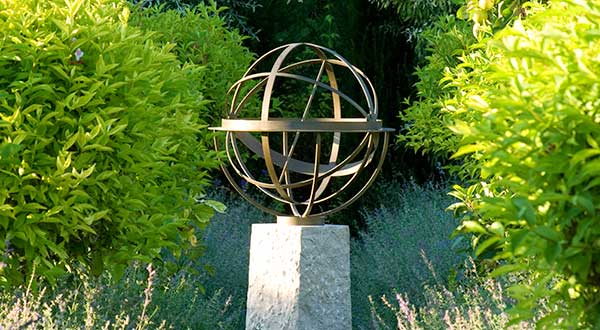 Brass armillary sphere on a stone plinth