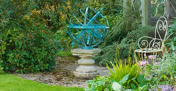 Bronze armillary sundial on a stone plinth
