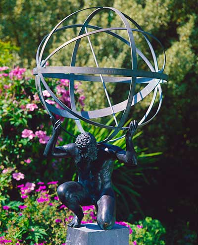 A bronze statue of Atlas, supporting a armillary sphere
