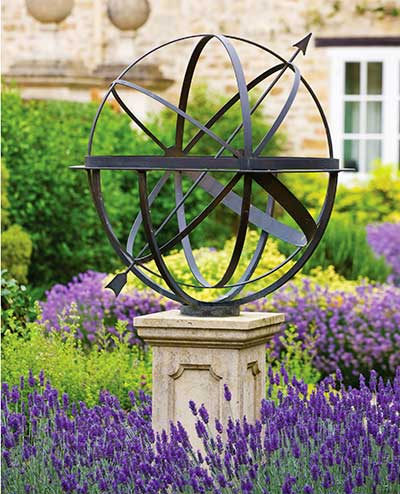 Brass armillary sphere in a beautiful lavender garden