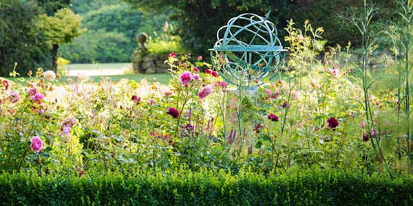 Bronze armillary sphere in a pretty garden
