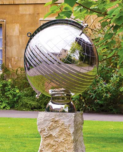 Globe sundial in stainless steel that doubles as a moon dial