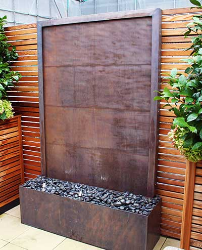 Copper wall art. Stylish water wall for the garden