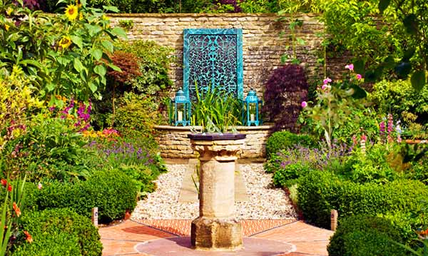 Bronze water wall in a garden
