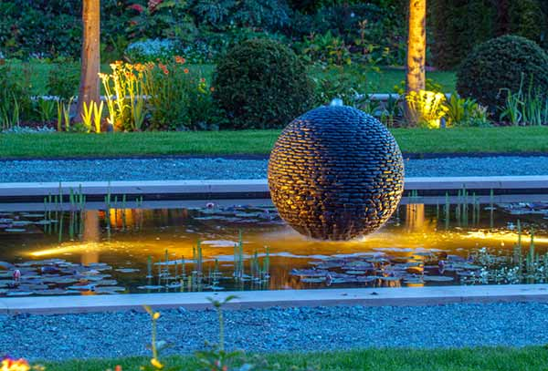 Dark Planet stone sphere water feature